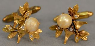 Pair of 14 karat gold cufflinks, each set with pearl and small diamond. 9.4 grams   Provenance: Estate of Peggy & David Rockefel...