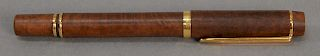 Waterman fountain pen, wood and gold, made in France with 18 karat tip. length 5 1/2 inches.   Provenance: Estate of Peggy & Dav...