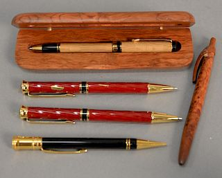 Six piece lot to include two Pierre Cardin pens, one Parker pencil, one Burlwood pen, a David Rockefeller stamp, and a cup. pens: le...