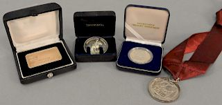 Four silver presentation medallions, two marked: To David Rockefeller. 6.4 troy ounces. diameter 1 1/2 inches to 2 inches.   Pro...