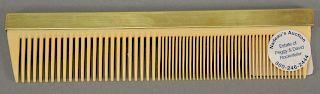 Rockefeller 10 karat gold handled comb. length 7 1/4 inches.   Provenance: Estate of Peggy & David Rockefeller having stamp/label.