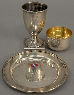 """Three silver pieces to include a small hand hammered cup with gold wash interior marked: """"Peggy Rockefeller The Gift of Two English ..."""