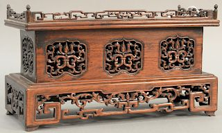 Chinese hardwood altar table top stand with reticulated carved gallery. height 7 1/2 inches, width 13 1/2 inches.   Provenance:...