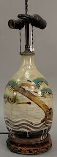 Asian earthenware glazed bottle having green blue enameled caterpillar with anchor and wavy decorated base with overall white wash g...