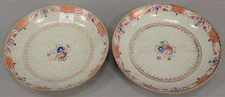 Pair of Chinese export deep plates having central floral design surrounded by enameled rings and basket weave designs along with a n...