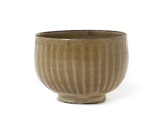 * A Chinese Green Glazed Stoneware Bowl Height 3 1/4 inches.