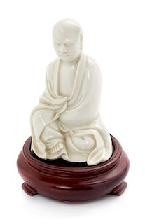 * A Chinese Blanc-de-Chine Porcelain Figure of a Luohan Height 4 inches.