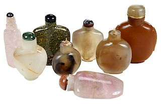 Eight Carved Asian Hardstone Snuff Bottles