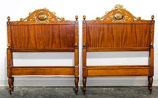 * A Pair of Italian Painted and Parcel Gilt Walnut Twin Beds Height 49 x width 39 1/2 x depth 82 inches.