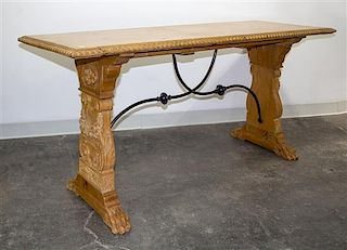 * A Spanish Baroque Style Iron Mounted Table Height 29 1/2 x width 66 x depth 25 inches.