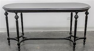 * A Louis XVI Style Ebonized Table Height 30 1/2 x width 59 x depth 20 inches.