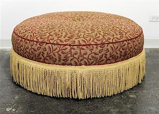 An Upholstered Ottoman Diameter 41 1/2 inches.