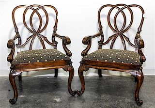 A Pair of Walnut Open Arm Chairs Height 42 inches.