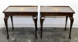 A Pair of Parcel Gilt End Tables Height 26 1/2 x width 31 x depth 21 1/2 inches.