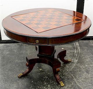 A Georgian Style Mahogany Flip-Top Games Table Height 29 1/2 x width 41 inches.