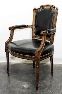* A Leather Upholstered Open Arm Chair Height 38 inches.