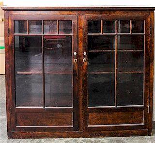 An American Oak Bookcase Height 54 1/4 x width 62 x depth 16 inches.