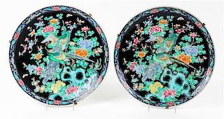* A Pair of Famille Noir Porcelain Chargers Diameter 14 1/2 inches.