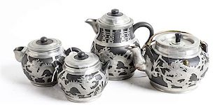 Four Chinese Pewter Mounted Yixing Pottery Tea Pots Height of tallest 6 1/8 inches.