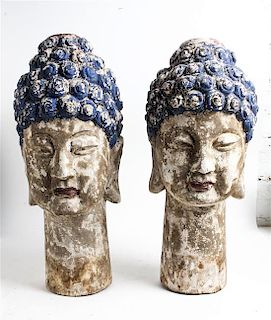 A Pair of Southeast Asian Painted Wood Heads of Buddha Height 25 inches.