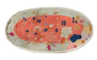 * An Oval Chinese Wool Rug 3 feet 10 inches x 1 foot 11 inches.