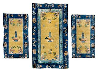 * A Group of Four Chinese Wool Rugs Largest 8 feet 8 inches x 8 feet.