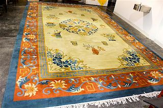 * A Chinese Wool Rug 17 feet 10 inches x 10 feet 10 inches.