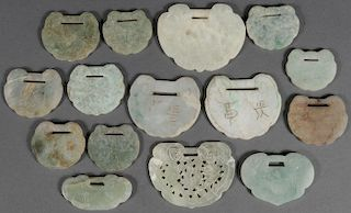 A GROUP OF 15 CHINESE CARVED JADE PENDANTS