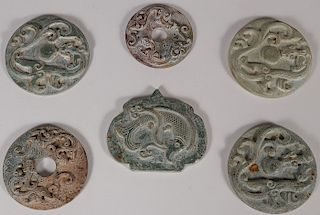 FIVE CHINESE CARVED HARDSTONE DISCS