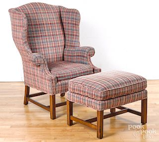 Baker Chippendale style wing chair and ottoman.