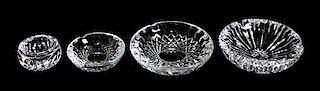 A Group of Four Waterford Crystal Ash Receivers Diameter of largest 7 inches.