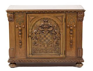 A Renaissance Revival Style Carved Walnut Side Cabinet Height 33 1/4 x width 44 x depth 19 inches.