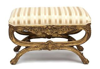 An Italian Rococo Style Painted and Parcel Gilt Curule-Form Tabouret Height 20 inches.