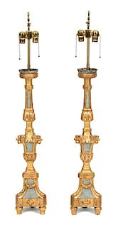 A Pair of Italian Rococo Style Painted and Parcel Gilt Prickets Height 30 inches.