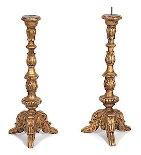A Pair of Italian Rococo Style Carved Giltwood Pricket Candlesticks Height 33 1/2 inches.