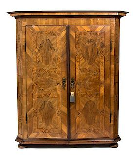 A South German Walnut Parquetry Armoire Height 77 1/2 x width 67 x depth 26 inches.