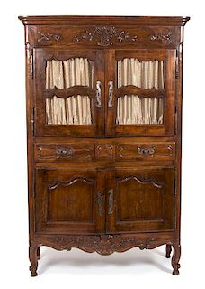 A French Provincial Carved Fruitwood Buffet a Deux Corps Height 79 1/2 x width 50 3/4 x depth 21 1/2 inches.