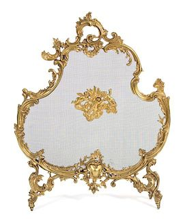 A Louis XV Style Gilt Bronze and Wire Mesh Cartouche-Form Fire Screen Height 33 3/4 x width 26 1/2 inches.