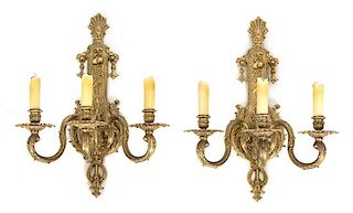 A Pair of Louis XV Style Gilt Bronze Three-Light Wall Sconces Height 18 x width 14 x depth 10 inches.