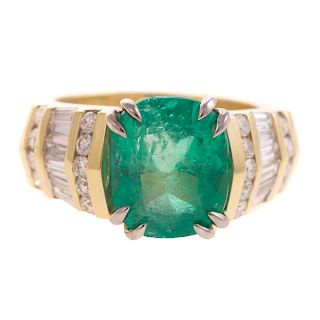 A Lady's 5.6 cts. Emerald & Diamond Ring in 18K