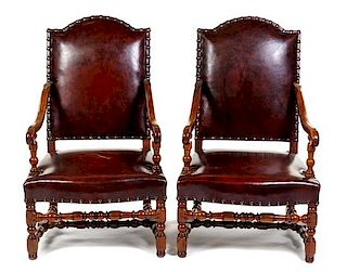 A Pair of Louis XIII Style Walnut Fauteuils Height 43 inches.