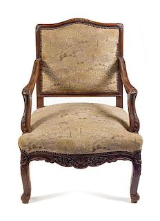 A Regence Walnut Fauteuil Height 37 inches.