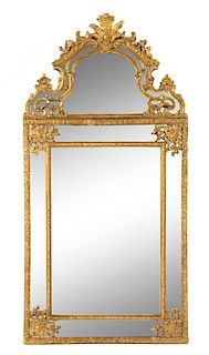 A Regence Style Giltwood Mirror Height 56 3/4 x width 28 1/2 inches.