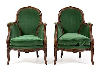 A Pair of Louis XV Beech Fauteuils Height 33 inches.