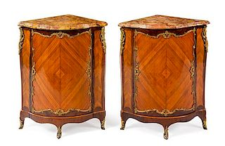 A Pair of Louis XV Gilt Bronze Mounted Palissandre and Tulipwood Encoignures Height 37 x width 28 1/2 x depth 20 inches.