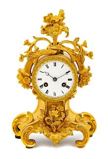 A Louis XV Style Gilt Bronze Mantel Clock Height 10 1/4 inches.