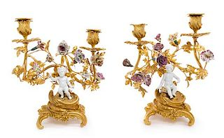 A Pair of Louis XV Style Porcelain Mounted Gilt Bronze Two-Light Candelabra Height 11 inches.