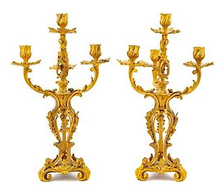 A Pair of Louis XV Style Gilt Bronze Four-Light Candelabra Height 19 inches.