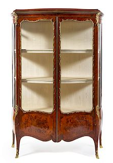A Louis XV Style Gilt Bronze Mounted Marquetry Vitrine Height 70 5/8 x width 47 x depth 15 1/2 inches.
