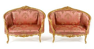 A Pair of Louis XV Style Painted and Parcel Gilt Settees Width 50 1/4 inches.
